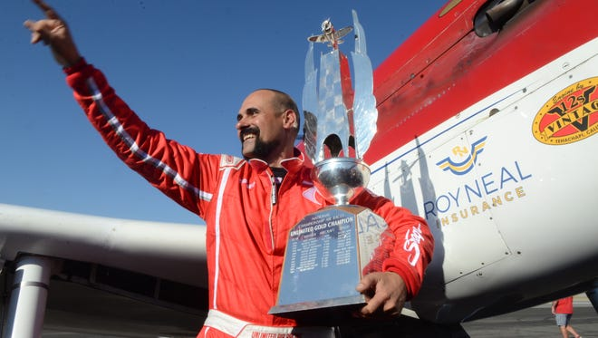 Jay Consalvi holds the first place trophy on Sunday following the Unlimited Gold Championship.