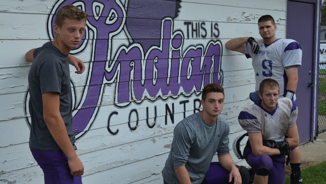 The Athens football team is on the verge of making the playoffs for the first time in 17 years, led by, from left, Andrew Oswalt, Cody Richardson, Parker Minier and John Martin.