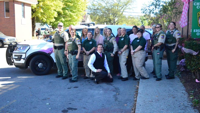 Female members of the Ashland City Police Department's administrative staff along with Cheatham County Sheriff's deputies and Sheriff Mike Breedlove got together Wednesday, Oct. 18, to support breast cancer awareness.