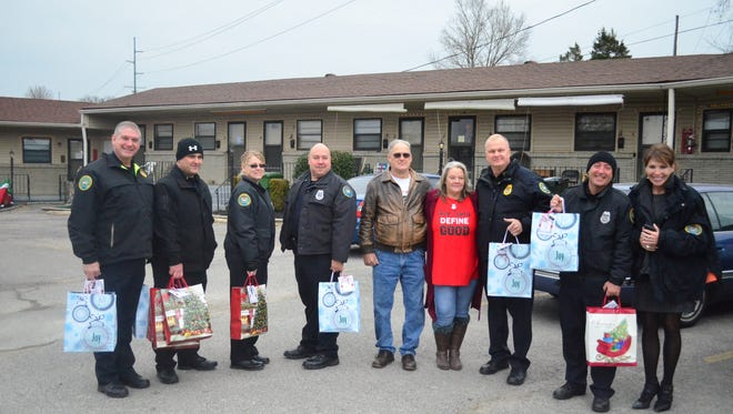 Gallatin Mayor Paige Brown and members of the Gallatin Police Department pose with representatives from the Sumner County Veterans Home before handing out Christmas presents to veterans.