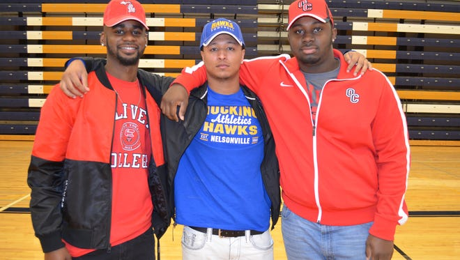 From left, Battle Creek Central's Michael Holley (Olivet College), Jordan Lawson (Hocking JC) and Cedrion Pierce (Olivet College) made their announcement Thursday as to where they would play college football.