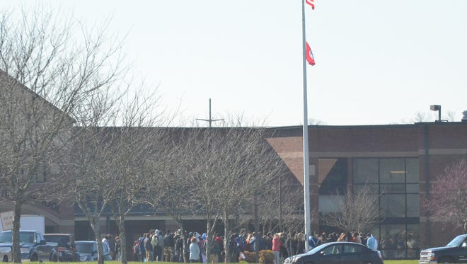 Students at Station Camp High School huddled around the flagpole during the National School Walkout event.