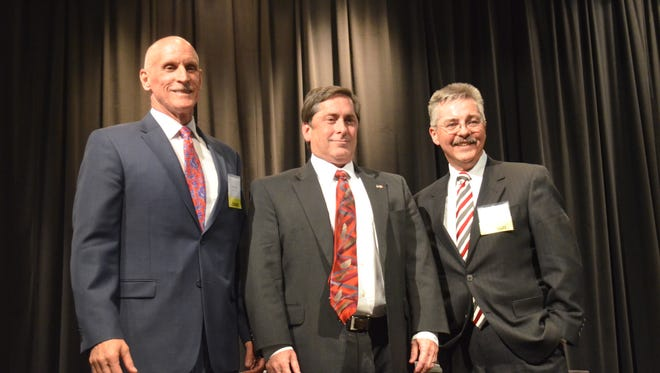 Anthony Holt, John Isbell and Jim Vaughn pose for a picture at  the Sumner County Candidate Forum and Reception at Volunteer State Community College April 19, 2018.