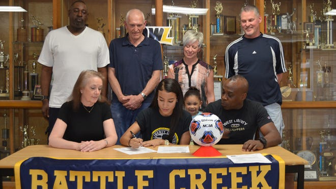 Battle Creek Central senior Sonata Beasley has committed to play soccer at Division II West Liberty. She is joined by her parents Robin Beasley and Barth Beasley along with family and friends.