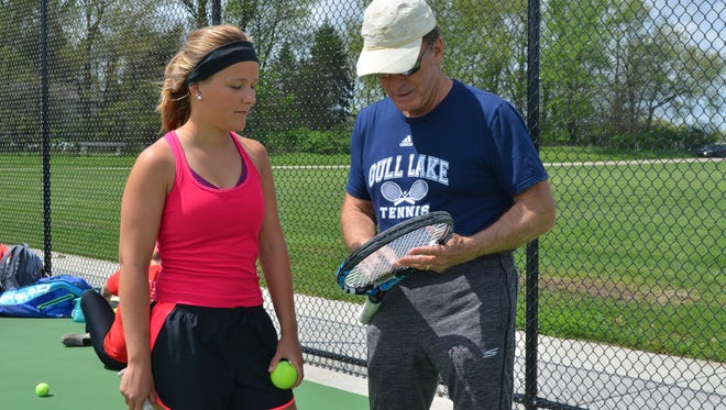 Gull Lake's Marie-Sarah Dumont, a foreign-exchange student from Belgium, works with her head coach Roger Cornelius. With Cornelius also being a French teacher at the school, they can speak the same language on the court.
