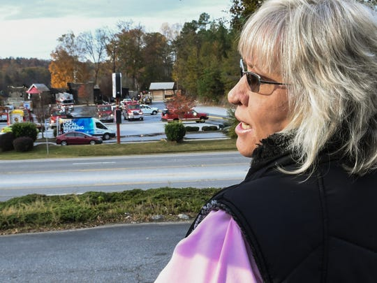 Pat Rhodes-Dickerson of Anderson recalls when her father Horace Rhodes built Dockmasters restaurant in 1992, while looking at the scene of a fire at Sake Zen on Clemson Boulevard near I-85 in Anderson early Tuesday morning.