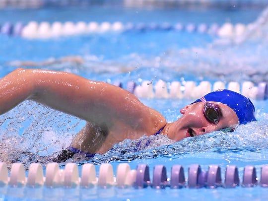 Lucy Callard wins the girls 1650 yard freestyle race