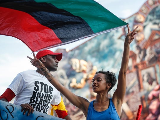 Black Lives Matter protesters march south on Broad