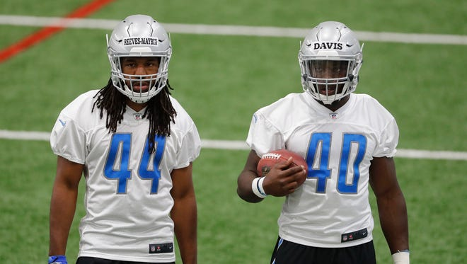 Lions linebackers Jalen Reeves-Maybin (44) and Jarrad Davis (40) listen during the team's rookie minicamp in Allen Park on May 12, 2017.