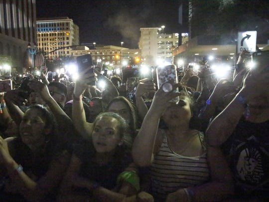 The crowd holds up lights on their mobile phones during the performance by Gucci Mane Sunday night..