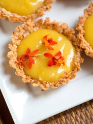 """Find this passion fruit orchid tartlet recipe in """"Cooking with Flowers"""" cookbook by Miche Bacher."""