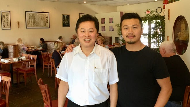 George Yu, left, and son Brentton Yu at Sailing Boat Chinese restaurant on Churn Creek Road in east Redding.