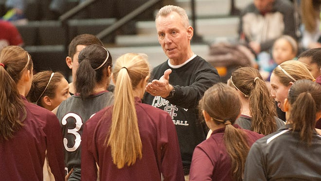 Henderson County Lady Colonels head basketball coach Jeff Haile talks to his players during a time-out.