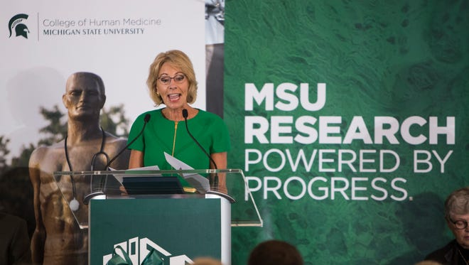 U.S. Secretary of Education Betsy DeVos speaks Wednesday, Sept. 20, 2017, at the opening of the MSU Grand Rapids Research Center.