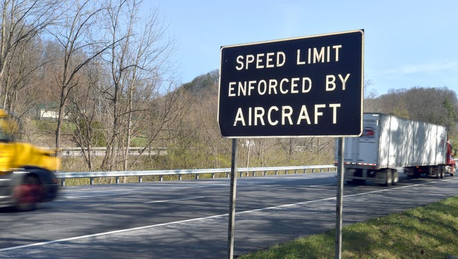 Signs on Interstate 81 in Bristol, Virginia, warn of speed limits being enforced by aircraft.