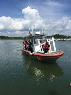 A crew from the U.S. Coast Guard Station Indian River Inlet on Monday retrieves one of the lifeguard stands discovered stolen Thursday in Rehoboth Beach.