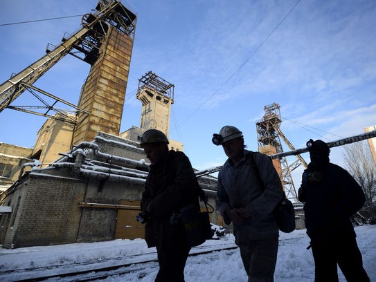 Miners return from their shift at the Kalinina coal