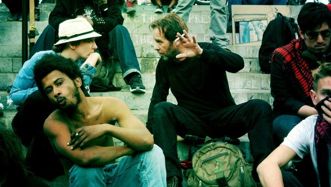 """Oshkosh native filmmaker Sam Slovick (center) directed """"Radicalized,"""" a documentary about young activists in Los Angeles during the Occupy Los Angeles protests."""