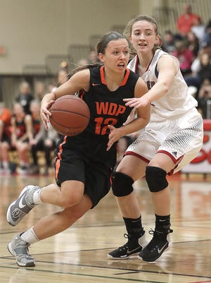 West De Pere senior Liz Edinger drives to the basket to score her 1,000th career point on Thursday at Seymour in a Bay Conference girls basketball game.