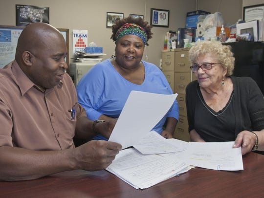 Michael McNeil, Exec director of STEPS (Solutions to End Poverty Soon), talks with his staff Angela Caldwell (center) Intake Specialist and Lynne Liotino, Vice Pres —June 26, 2015-Lakewood, NJ.-Staff photographer/Bob Bielk/Asbury Park Press