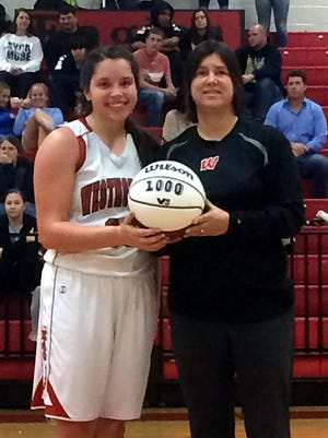 Westmoreland High senior Karley Smith scored her 1,000th point on Tuesday in the Lady Eagles' 57-31 victory over Sycamore. Smith is pictured with Westmoreland head coach Cherie Abner.
