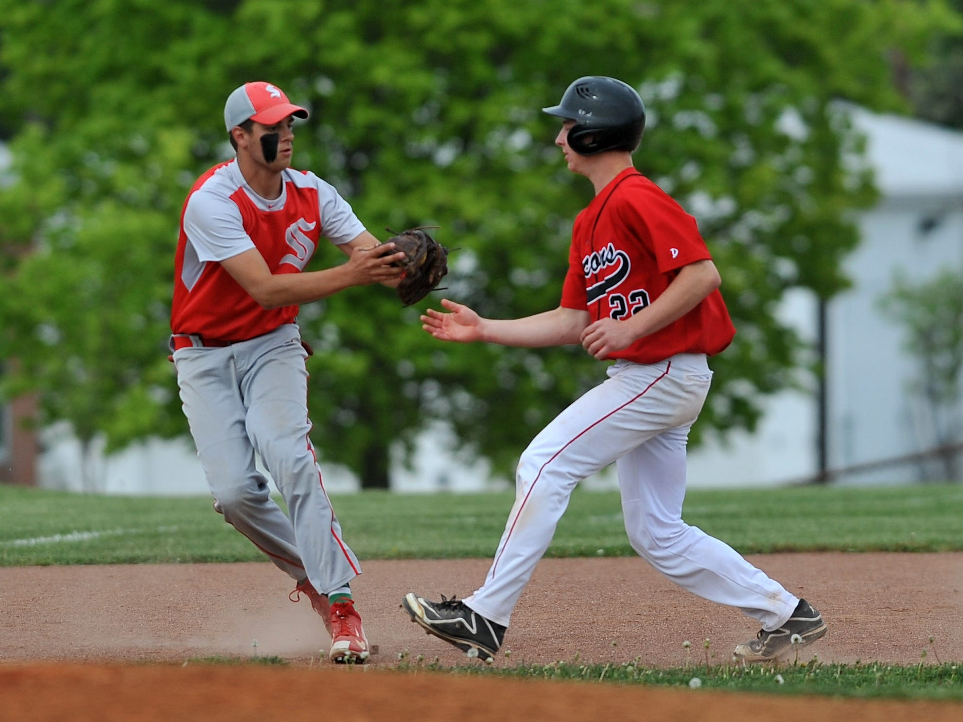 Sheridan third baseman Connor Dupler, left, tags out Fairfield Union's Hayden Price during Thursday's game at Fairfield Union High School in Rushville. The Falcons lost 3-2 to the Generals in eight innings.