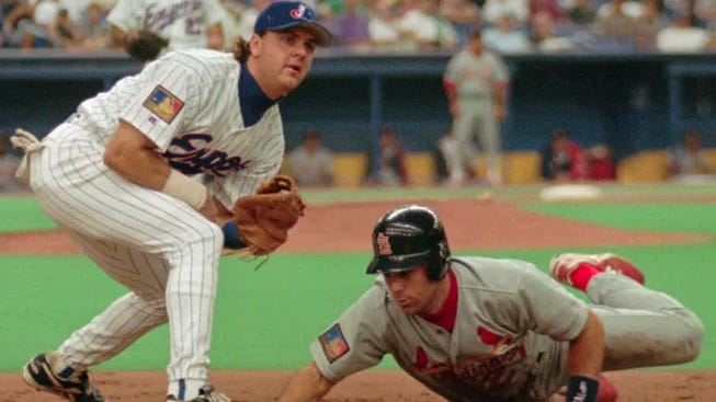 Montreal Expos first baseman Larry Walker looks to catch St. Louis Cardinals baserunner Todd Zeile off the bag during a 1994 game in Montreal.