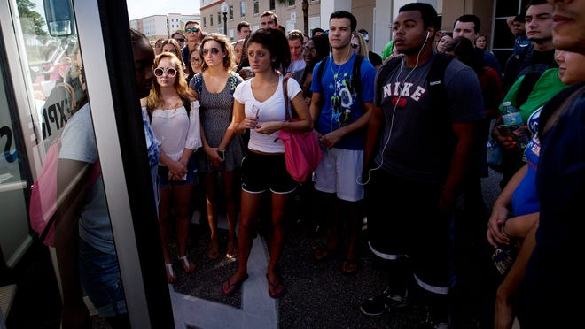 Florida Gulf Coast University students prepare to board a shuttle bus to the main campus from their residence halls in South Village on Wednesday 9/3/2014. FGCU has the highest percentage of students living on campus among traditional public universities in Florida.