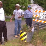 Opelousas City Councilman Tyrone Glover, far left, surveys the deteriorating Patsy Street bridge Friday with city of Opelousas maintenance superivisor, Fred Henderson, center, and nearby resident, Raymond Lavergne.