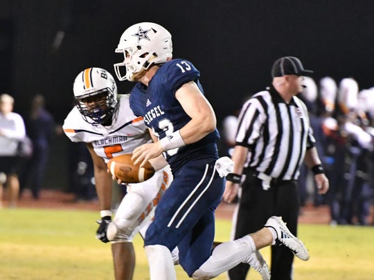 Siegel QB Brendan Crowell scrambles during a recent