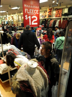 Shoppers visit the Aeropostale store at the Camarillo Premium Outlets on Thanksgiving night 2015.