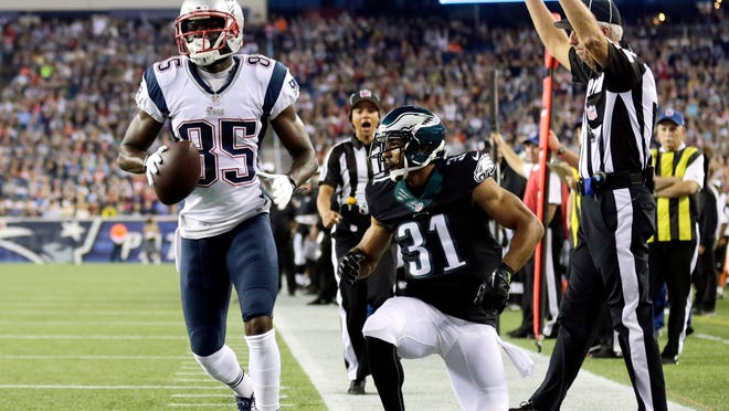 New England Patriots wide receiver Kenbrell Thompkins scores a touchdown in front of Eagles defensive back Curtis Marsh in the first quarter of their preseason game Friday in Foxborough, Mass.