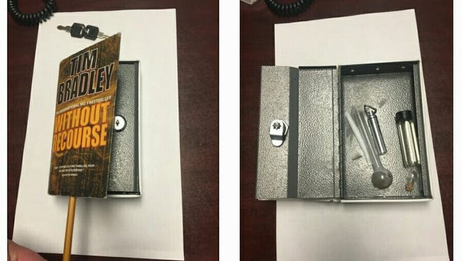 Contraband seized from inmates at the Westchester County jail in 2016 included this safe, which was hidden in a paperback book and contained drug paraphernalia.
