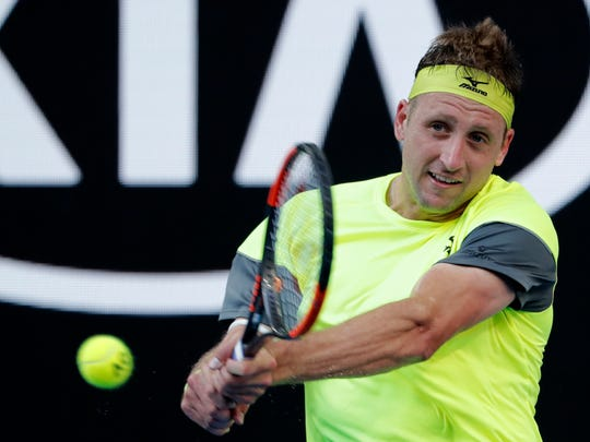 United States' Tennys Sandgren makes a backhand return to Austria's Dominic Thiem during their fourth round match at the Australian Open tennis championships in Melbourne, Australia, Monday, Jan. 22, 2018. (AP Photo/Vincent Thian)