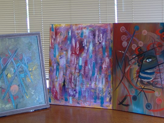 Three of 10 oil paintings by Jim Huff that will be