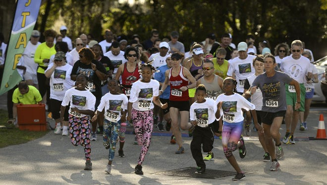 Runners start fast in the inaugural Freedom 5K at the Harry T. and Harriette V. Moore Memorial Park.
