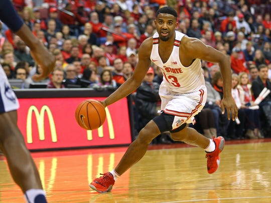 Ohio State Buckeyes guard JaQuan Lyle (13) dribbles the ball against the Connecticut Huskies in the first half at Value City Arena. Ohio State won 64-60.