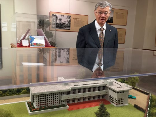 Tom Monaghan, founder of Domino's pizza and Domino's Farms and former owner of the Detroit Tigers, stands near a model of the Turkel House in Detroit, a home designed by Frank Lloyd Wright that Monaghan once owned. He is photographed at Domino's Farms in Ann Arbor on June 13, 2017.