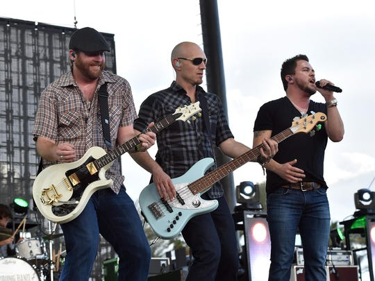 Lead guitarist James Young, bassist Jon Jones and singer Mike Eli of the Eli Young Band perform onstage during last year in Indio, Calif.