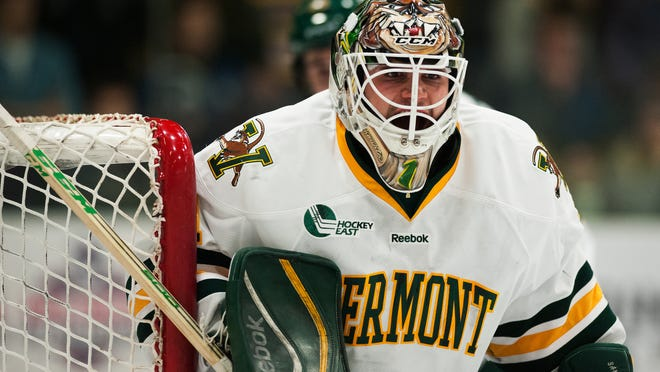 Catamounts goalie Mike Santaguida (1) keeps an eye on the action during the men's hockey game between the Merrimack Warriors and the Vermont Catamounts at Gutterson Fieldhouse on Friday night.