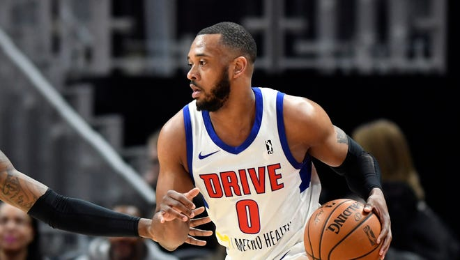 In a photo from Feb. 28, 2018, Grand Rapids Drive forward Zeke Upshaw looks to pass during a basketball game in Detroit. Upshaw, the Detroit Pistons developmental player who collapsed on the court during a NBA G League game in Michigan has died. The Grand Rapids Drive says 26-year-old Upshaw died at a hospital Monday, March 26, 2018. No cause was disclosed.