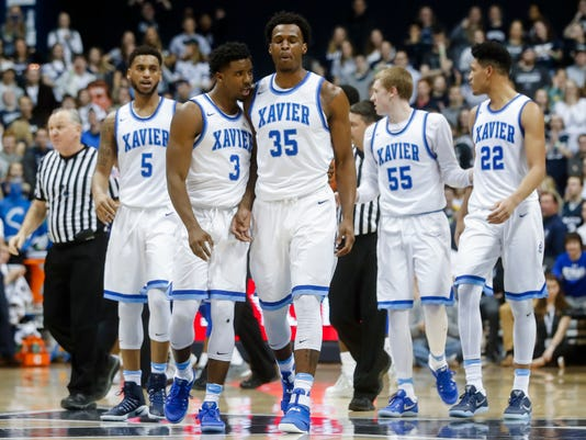 Xavier's RaShid Gaston (35) reacts alongside Quentin Goodin (3) after a scuffle with Seton Hall players during the second half of an NCAA college basketball game, Wednesday, Feb. 1, 2017, in Cincinnati. Xavier won 72-70. (AP Photo/John Minchillo)
