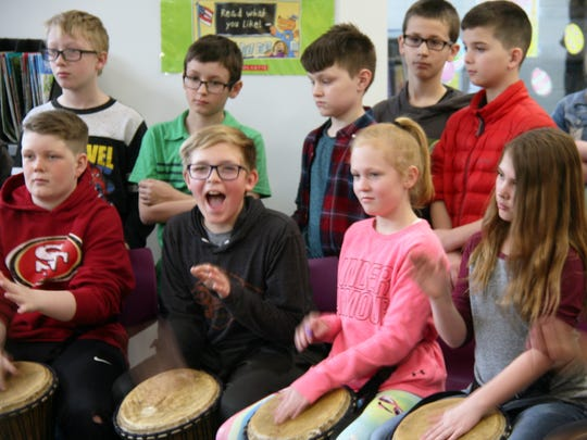 Students at Indianola's Emerson Elementary learned to play the drums during the school's annual Culture Day celebration. The students learned about various African cultures this year. Before playing the drums, the students rubbed the top of the goat skin drums as a sign of respect to the animals.
