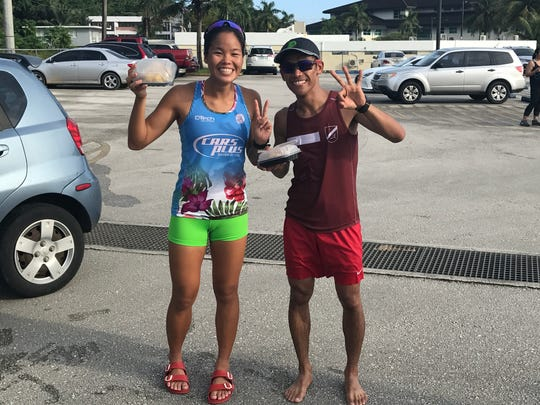 Manami Iijima, left, and Ryan Matienzo, right, were the top female and male finishers in the Guam Running Club Spirit of '76 Run on July 4 in Hagåtña.