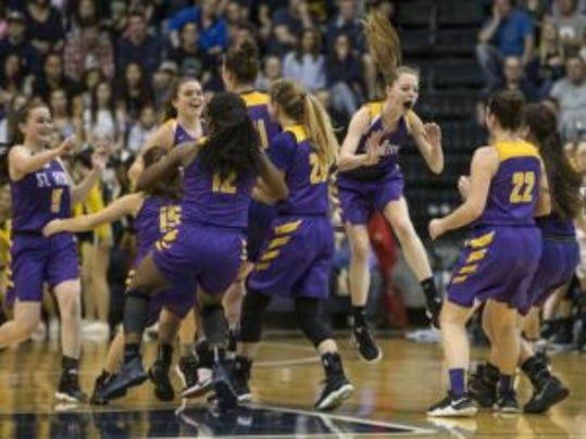 The St. Rose girls basketball team celebrates winning the 2017 SCT title at Monmouth University on Feb. 25, 2017