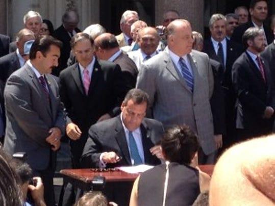 Gov. Chris Christie at signing of arbitration cap bill Thursday.