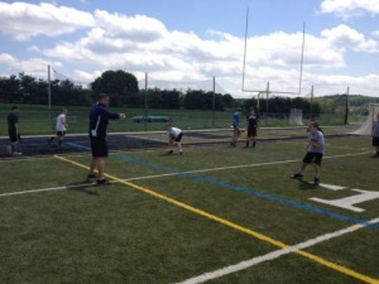 "Tim Pernetti, a college teammate of Scott Patkochis and Rutgers' former athletic director, works with youngsters Saturday at ""Scott's Big Man Camp."" (Ryan Dunleavy/MyCentralJersey.com)"