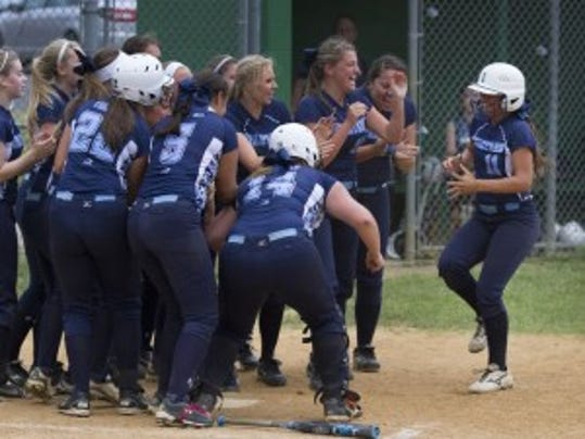 Senior Leigh Ann Greenwald is greeted at home plate after homering in Immaculata's 3-0 sectional victory over St. John Vianney on Tuesday
