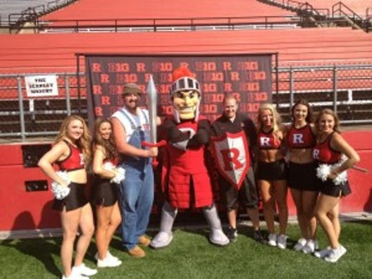 Rutgers football 2016 commit Ted Field poses with the new-look Scarlet Knight and cheerleaders. (Ryan Dunleavy/MyCentralJersey.com)