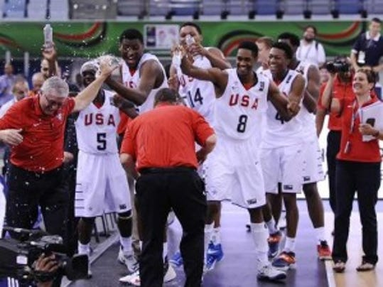 Tyus Battle (No. 4, far right) celebrates with the rest of the U-17 world champions